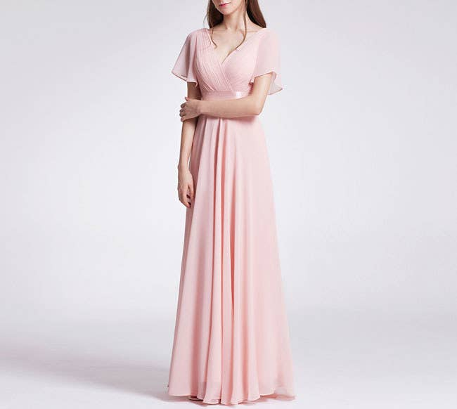 a845f4267a87 A floor-length gown with an empire waist and flutter sleeves can make you a  vision no matter where you wear it.