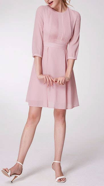 94e890fde09f An adorable dress with pleating on the bust and a minimal silhouette you  can easily transition from day to night.