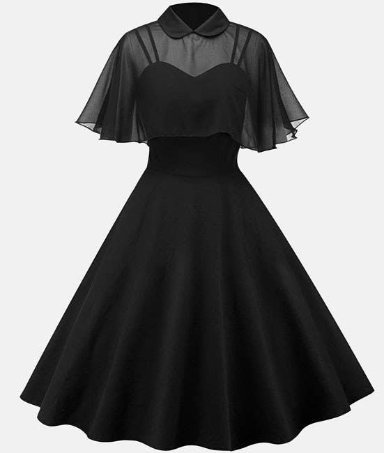b9937db95333 A fabulous swing dress with a sheer cloak neckline for bringing an  unexpected twist to the classic look
