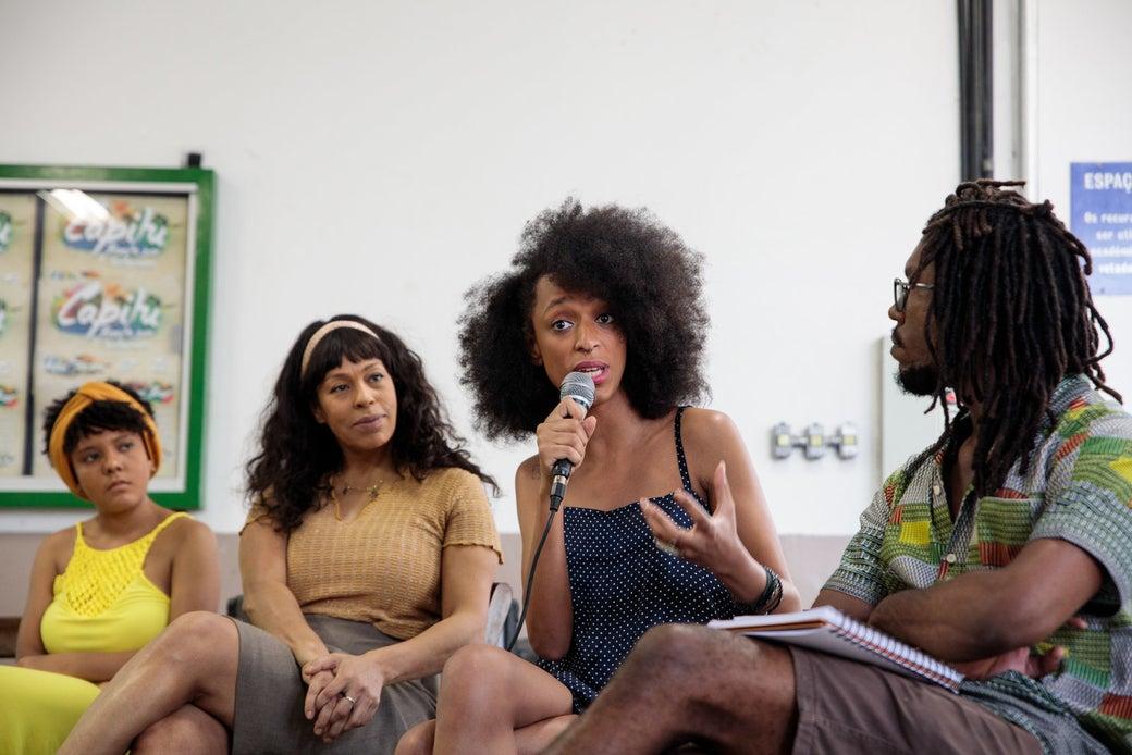 Erika Hilton speaks at a talk during Black Consciousness Week.
