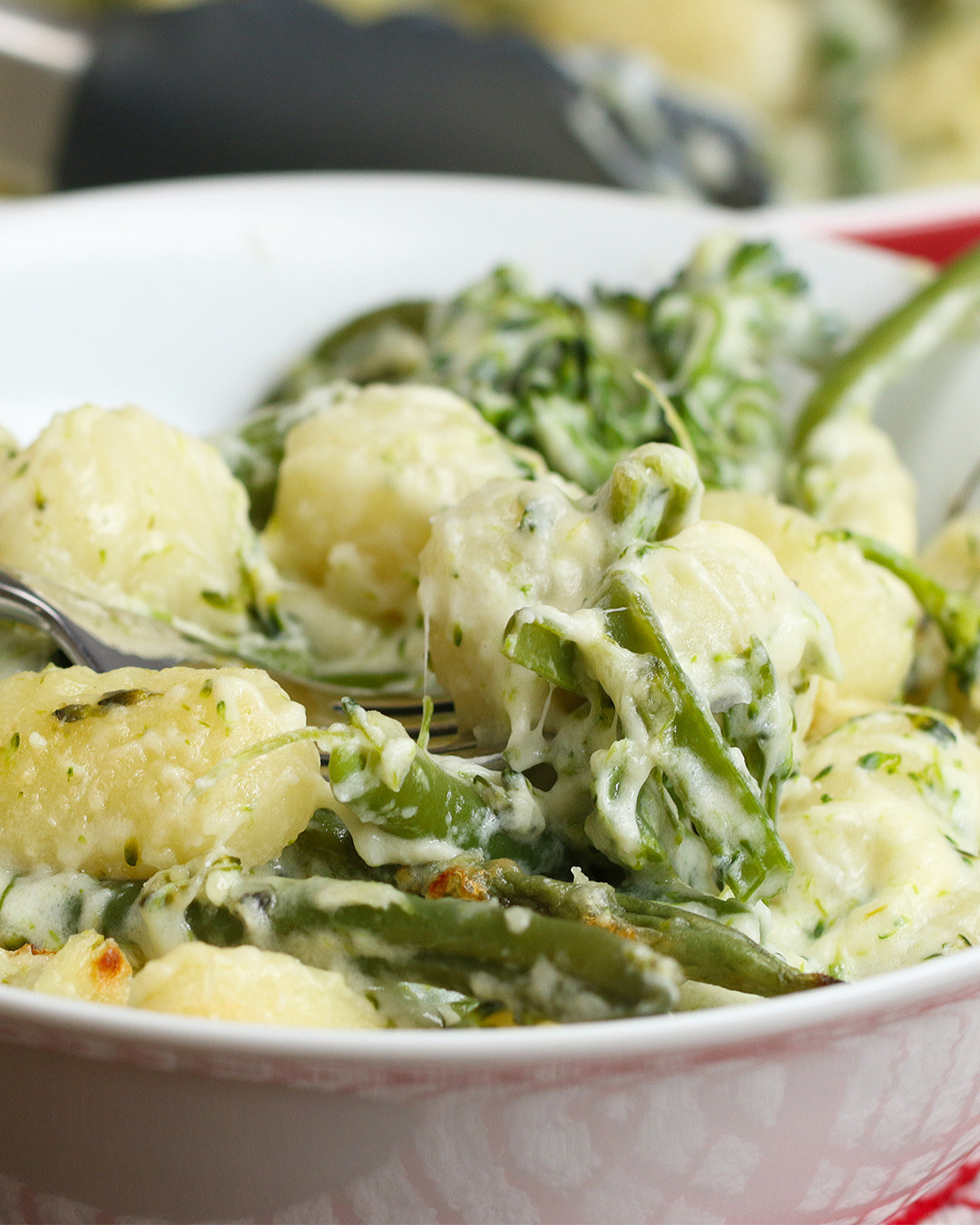 All you need is:– Green beans– Broccoli– Gnocchi– Mozzarella cheese– Parmesan cheese– Single cream– PepperGet the full recipe video here!
