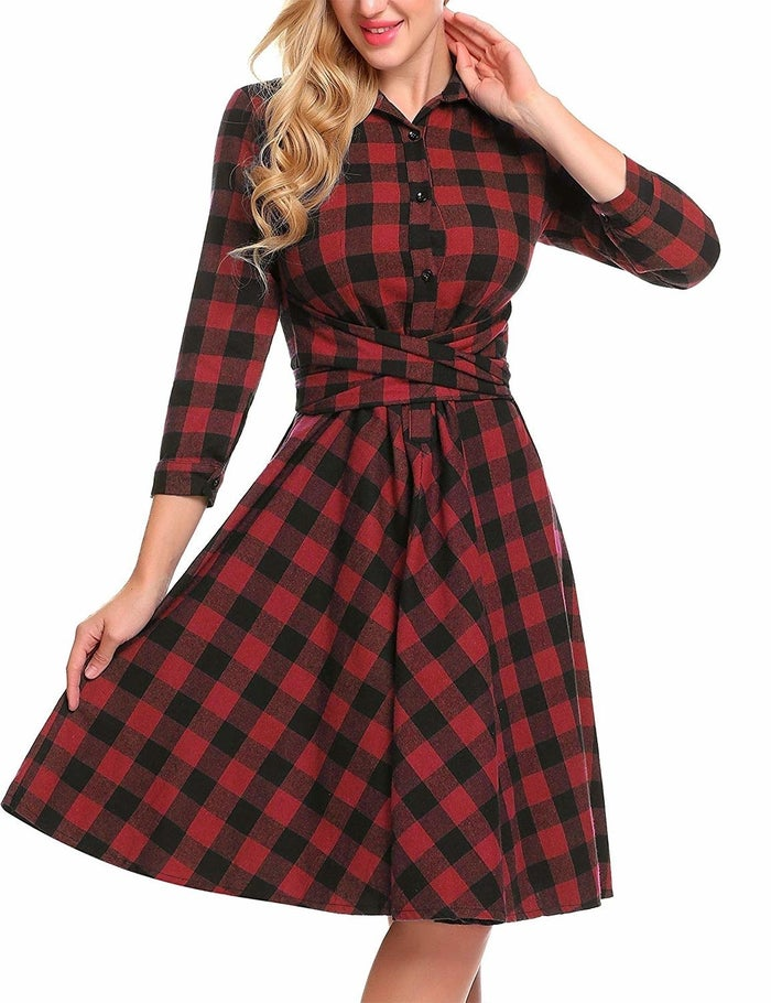 """Promising review: """"This is a warm, comfortable dress. It's a winter dress for me, very festive while still appropriate for work because of the flannel material. The cotton is substantial while still being soft. The buttons aren't the best quality but seem decent enough for now. I'm very satisfied and have already gotten several compliments on my first day wearing it."""" —AnnacondaGet it from Amazon for $26.99 (available in sizes S–2XL and six colors)."""