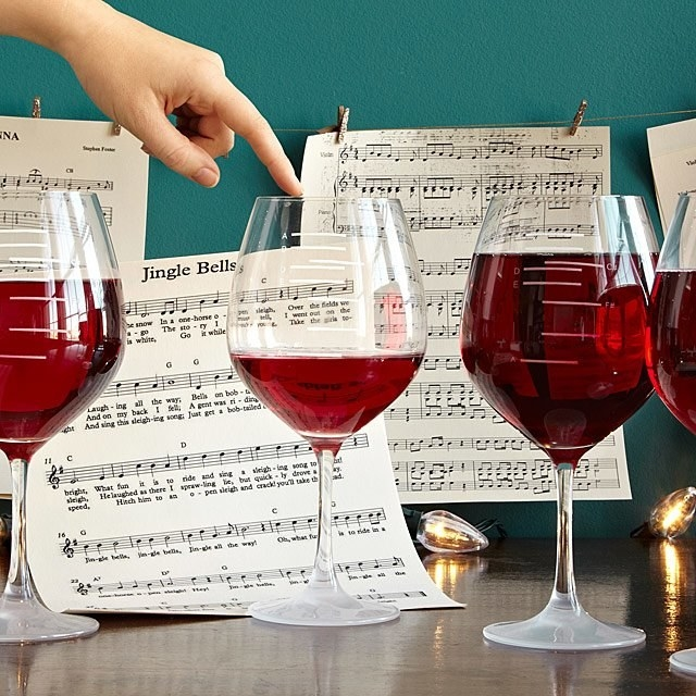 The glasses, with markings for different notes on the side