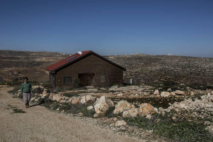 Inbal Zeev walks by her guesthouse advertised on Airbnb's international home-sharing site in Nofei Prat settlement in the West Bank, Jan. 17, 2016.