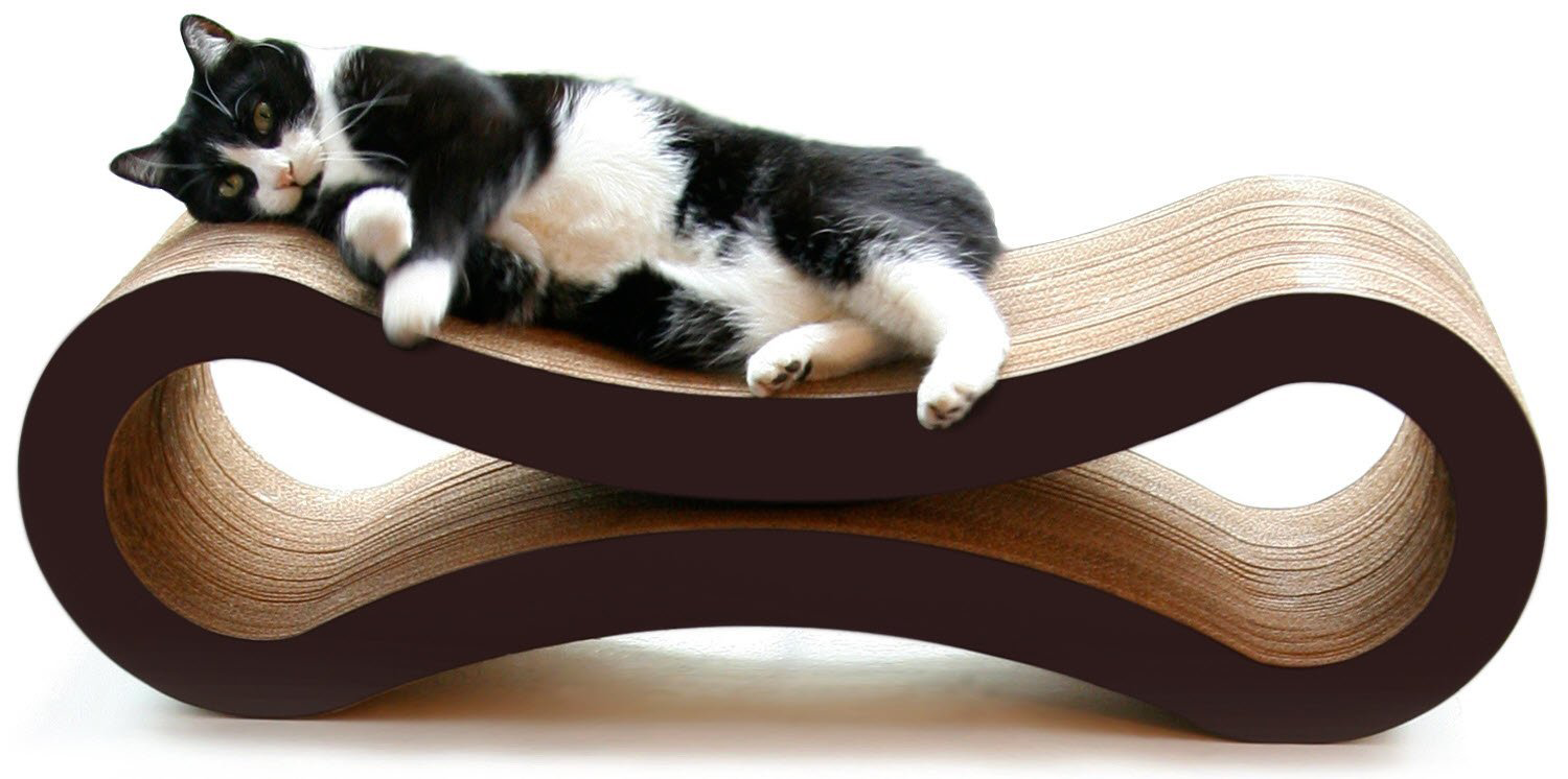 A cat lounging atop a three-dimensional cardboard scratcher with a concave top and bottom