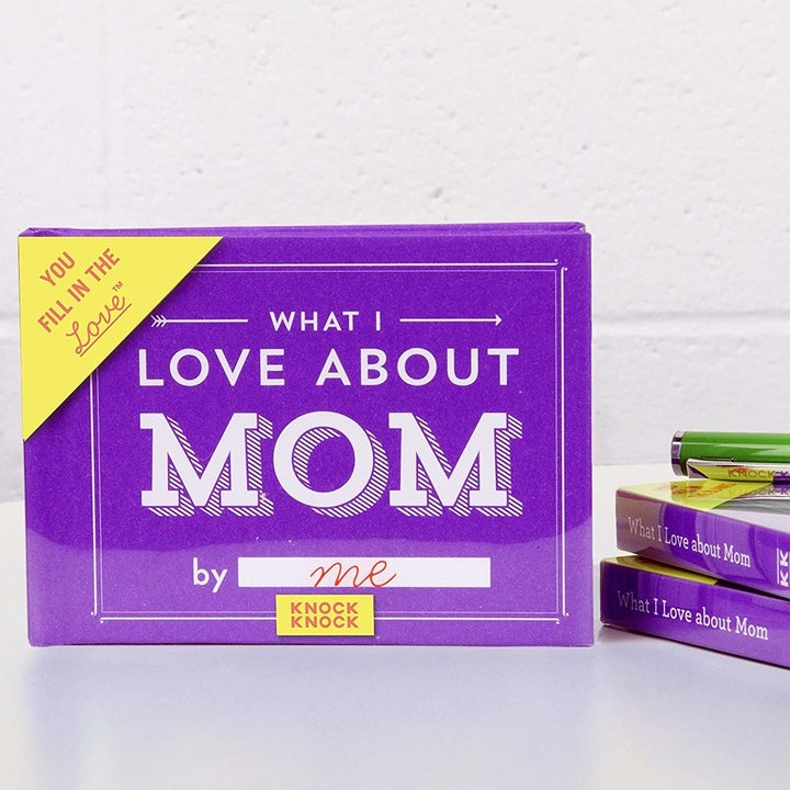"The purple ""What I love about Mom by blank"" book"