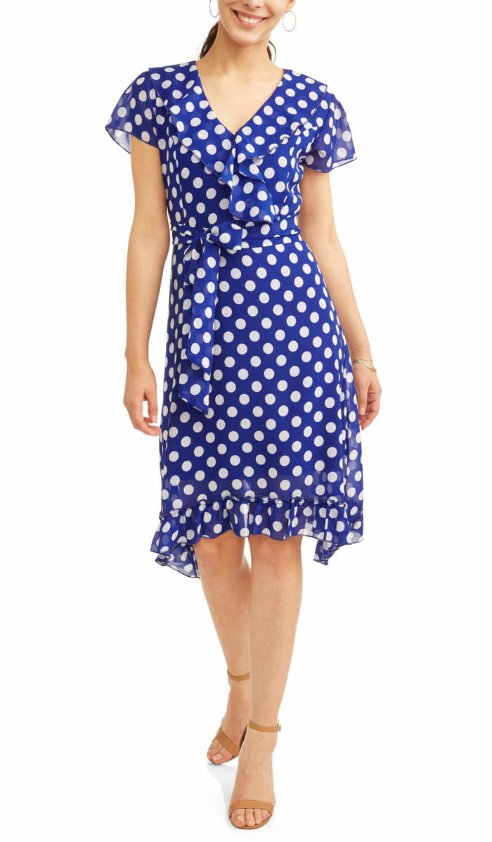 21de8e64e777 A polka dot wrap dress that'll have you ready to dance all night with its  ruffled hemline and sleeves.