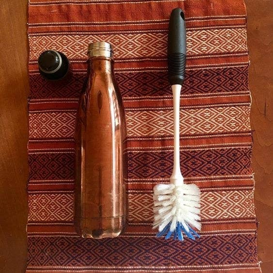 "The brush has a non-slip grip and both hard and soft bristles for effective yet scratch-free scrubbing. Promising review: ""I just purchased a 32 oz narrow-mouth water bottle and needed something to be able to clean it. Thus the OXO Good Grips bottle brush. Boy was I impressed with what I thought was going to be a simple, basic item. The handle is long and sturdy and the brush is hard enough to be sure to get the job done and soft enough to not scratch. The brush gently squeezes into my water bottle, then expands and provides a thorough cleaning. It is also excellent for cleaning tall glasses where you don't want to take a chance getting your hand in there. I am confused by some saying the handle or item itself is too small. The handle by itself is 10 inches and the brush is 3 inches for a total of 13 inches. I experimented with bottles with different size openings and found this brush could squeeze into anything with an opening even as small as 3/4 inches and then expand to fully clean. Very impressed with this durable brush. Lastly it also has a rubber grip on the top portion of the handle to help make cleaning even easier. Definitely recommend."" —barryGet it from Amazon for $4.99."
