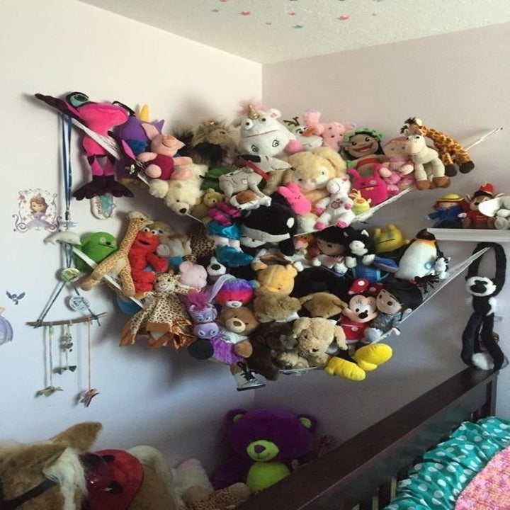 A reviewer's plush collection hanging in the hammock