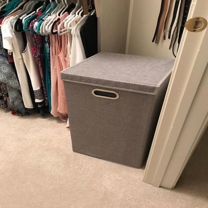 A reviewer's laundry hamper in a closet