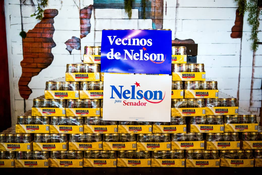 Campaign signs for Sen. Bill Nelson, a Democrat from Florida, are displayed on cases of Medalla, a Puerto Rican beer, in the Little Havana neighborhood of Miami on July 14.