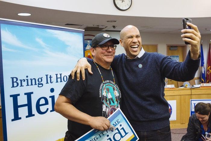 Sen. Cory Booker takes a selfie with Standing Rock council member Kory McLaughlin.