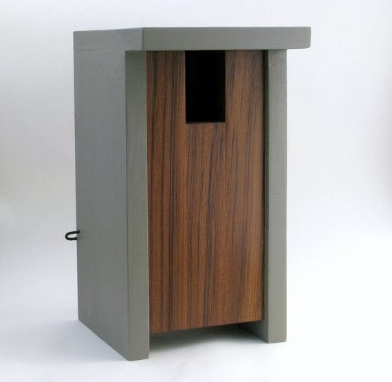 A gray and brown tall, geometric birdhouse