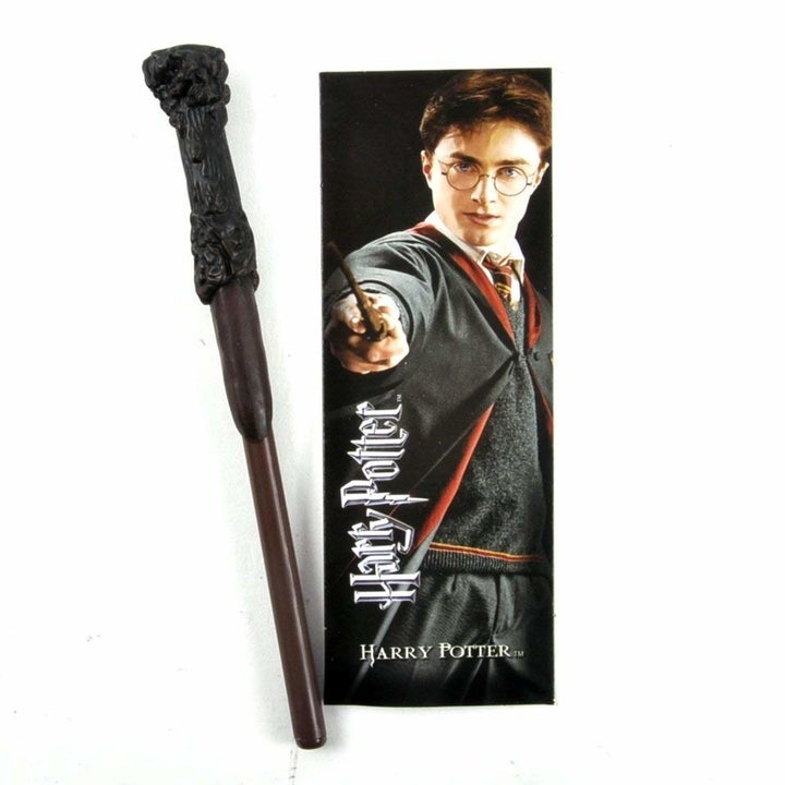 The Harry Potter wand pen and bookmark; the bookmark features a photo of Harry from the movies
