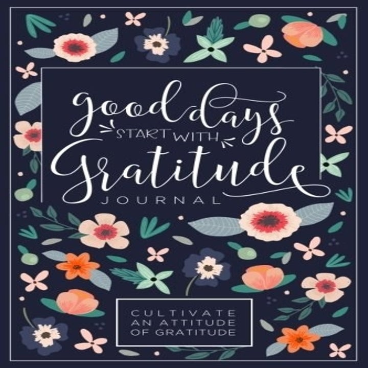 "The cover, which is floral and says ""good days start with gratitude, a journal"""