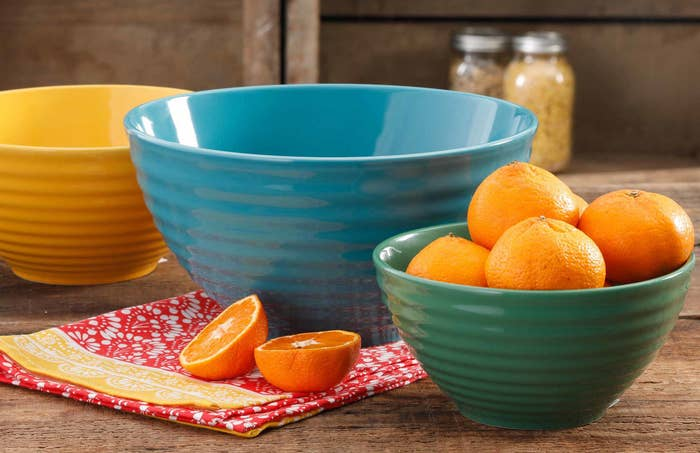"""Comes with one 10"""" bowl (teal), one 8.5"""" bowl (yellow), and one 7"""" bowl (green). They feature ribbed exteriors and smooth interiors for easy mixing and easy gripping.Get them from Walmart or Jet for $28.46."""