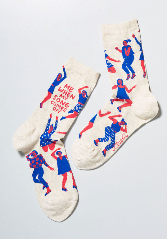 """white socks with red and blue characters dancing with the words """"when my song comes on"""""""