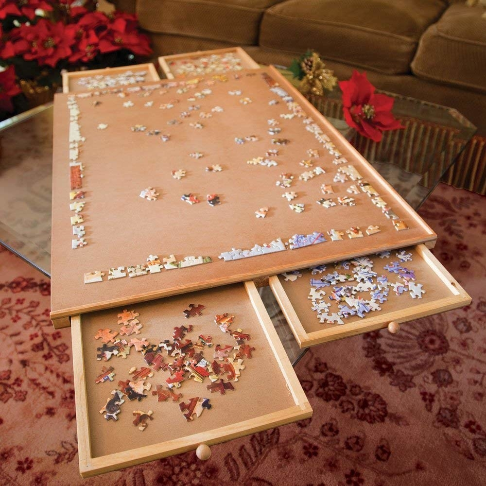 tabletop with drawers that pull out in separated groups of puzzle pieces