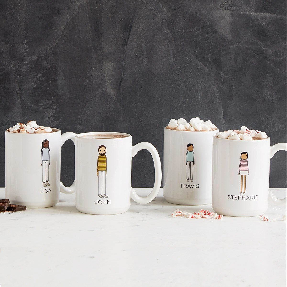 four coffee mugs with cartoons and names on them