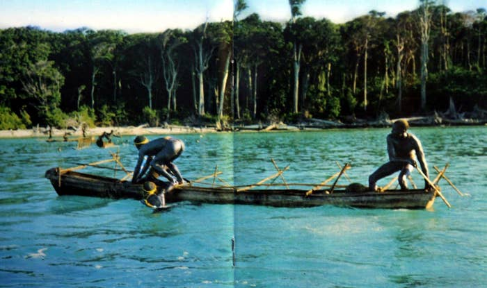 In this undated photo released by the Anthropological Survey of India Sentinelese tribe, men row their canoe in Indias Andaman and Nicobar archipelago.
