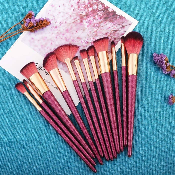 """You'll get a powder brush, blush brush, foundation brush, contour brush, fan brush, blending brush, eyeshadow brush, nasal shadow brush, two eyeshadow brushes, round blending brush, and eyebrow brush. Promising review: """"These are BEAUTIFUL. They don't feel cheap and I (gently) tugged the bristles to see if strands come loose easily, and they don't. They have very long handles that make these comfortable to hold. Definitely a good buy!"""" —Rachel WGet a set of 12 from Amazon for $10.99."""