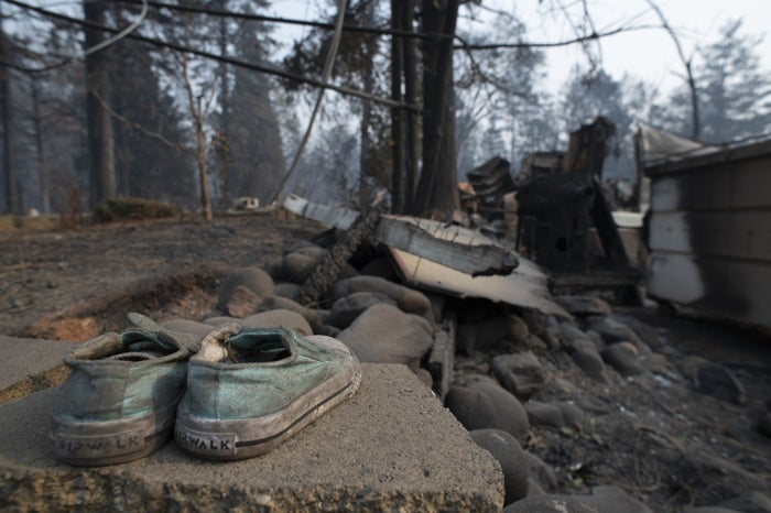 A family searches through the ashes of their burned home in Paradise, California.