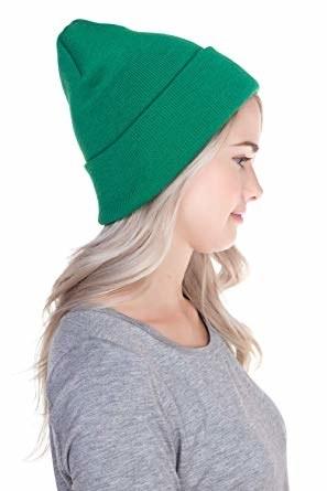 model wearing a bright green beanie hat