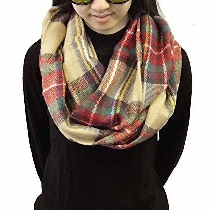 model wearing the infinity scarf in a plaid pattern
