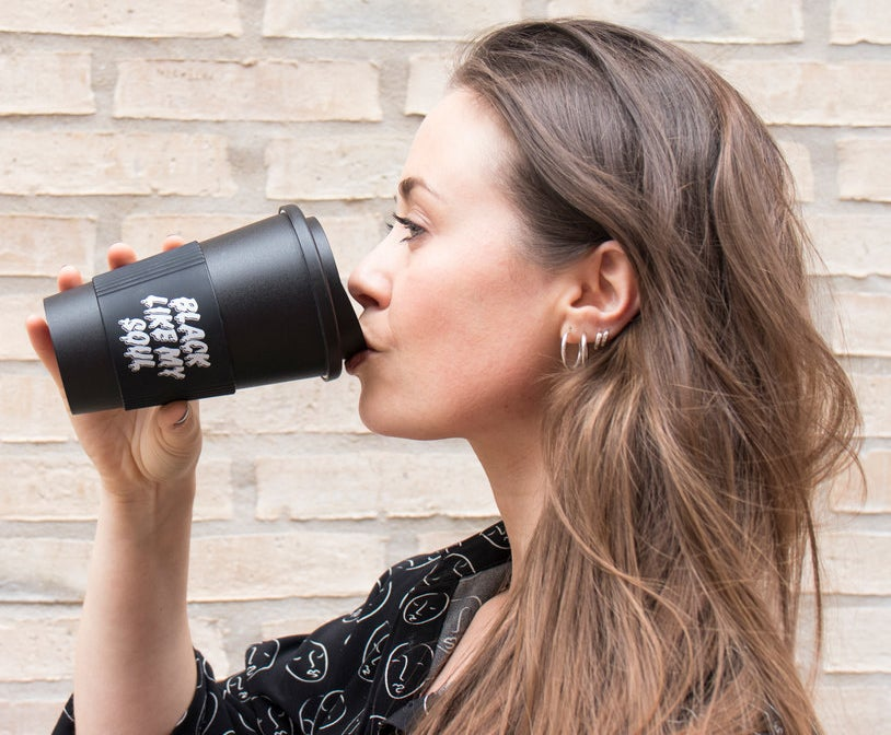 """It says """"Black like my soul,"""" just in case you can't read it! This travel mug is BPA-free, dishwasher, and microwave safe (apart from the sleeve)!Get it from Firebox for $13.99."""