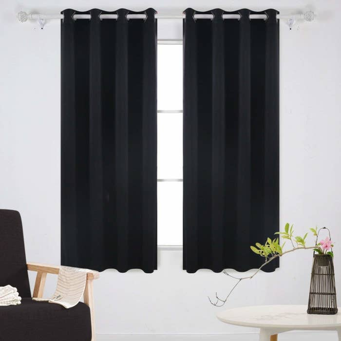 """Promising review: """"I bought the black ones for maximum blackout and they work great!! I have 96 inch wide windows and bought two 80 inch wide curtains for coverage. We live in Phoenix and noticed an appreciable decrease in our room temperature as well! Material is soft, shiny, and looks great! Highly recommend these, but make sure you get at least double the inches you need in width, and the darker the curtain the better the blackout."""" —Emily N. SummerRead a BuzzFeeder's full review on the Deconovo blackout curtains to find out why these curtains are #SleepGoals.Get them from Amazon for $21.99+ (available in three sizes and 21 colors)."""