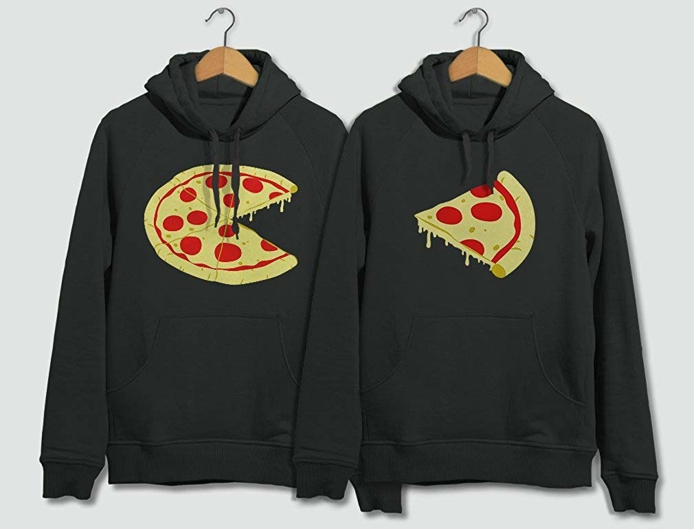 Two black hoodies, one with an entire pizza missing one slice and the other with the missing slice