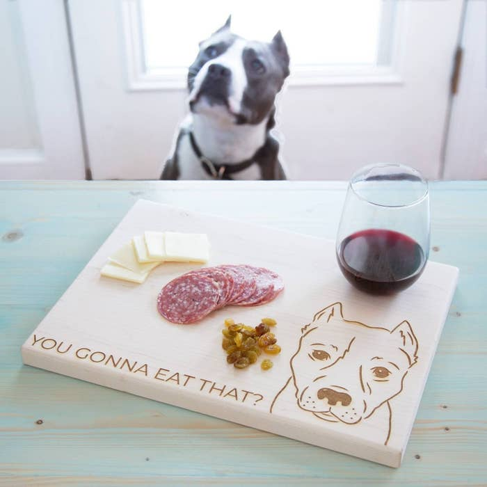 2c53e113cf5a An engraved cutting board with their pet s face accompanied by the one  saying you know they would say if they could talk.