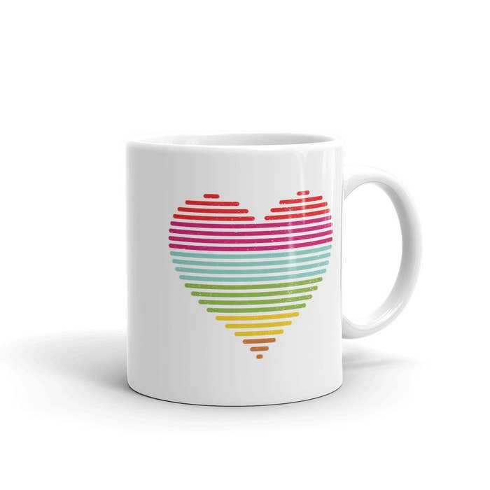 """This mug's rainbow heart design is charged with sparklingly clear, healing energy from real energy healers, so that anything you drink out of it can bring you instant good vibes!Promising quote: """"Anyone who has the design printed on a mug can expect healing on the mind, body, and spiritual levels, as well as a deeper sense of love, light, and grace, and a deeper connection with their soul self and their soul family."""" -- Reiki Master Mindie AdamosGet it from Maggie and Moe for $12.99."""