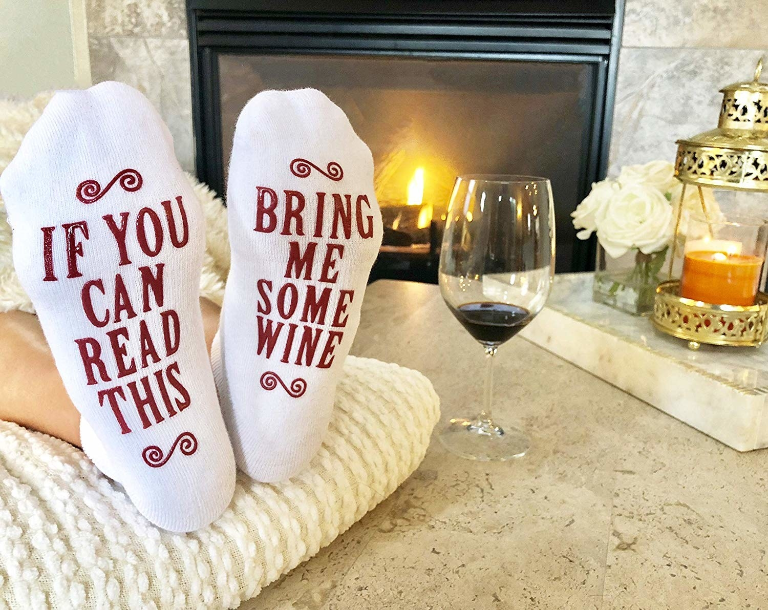 "The socks that say ""if you can read this"" on one and ""bring me some wine"" on the other on the soles"