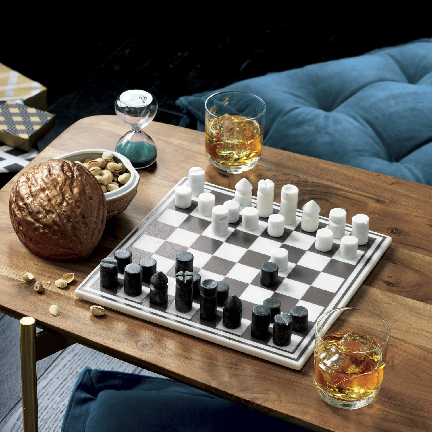The small square black and white checkered board with black and white marble pieces