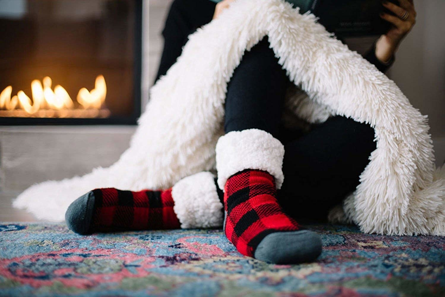 Feed in the buffalo plaid socks cuffed to show the sherpa lining