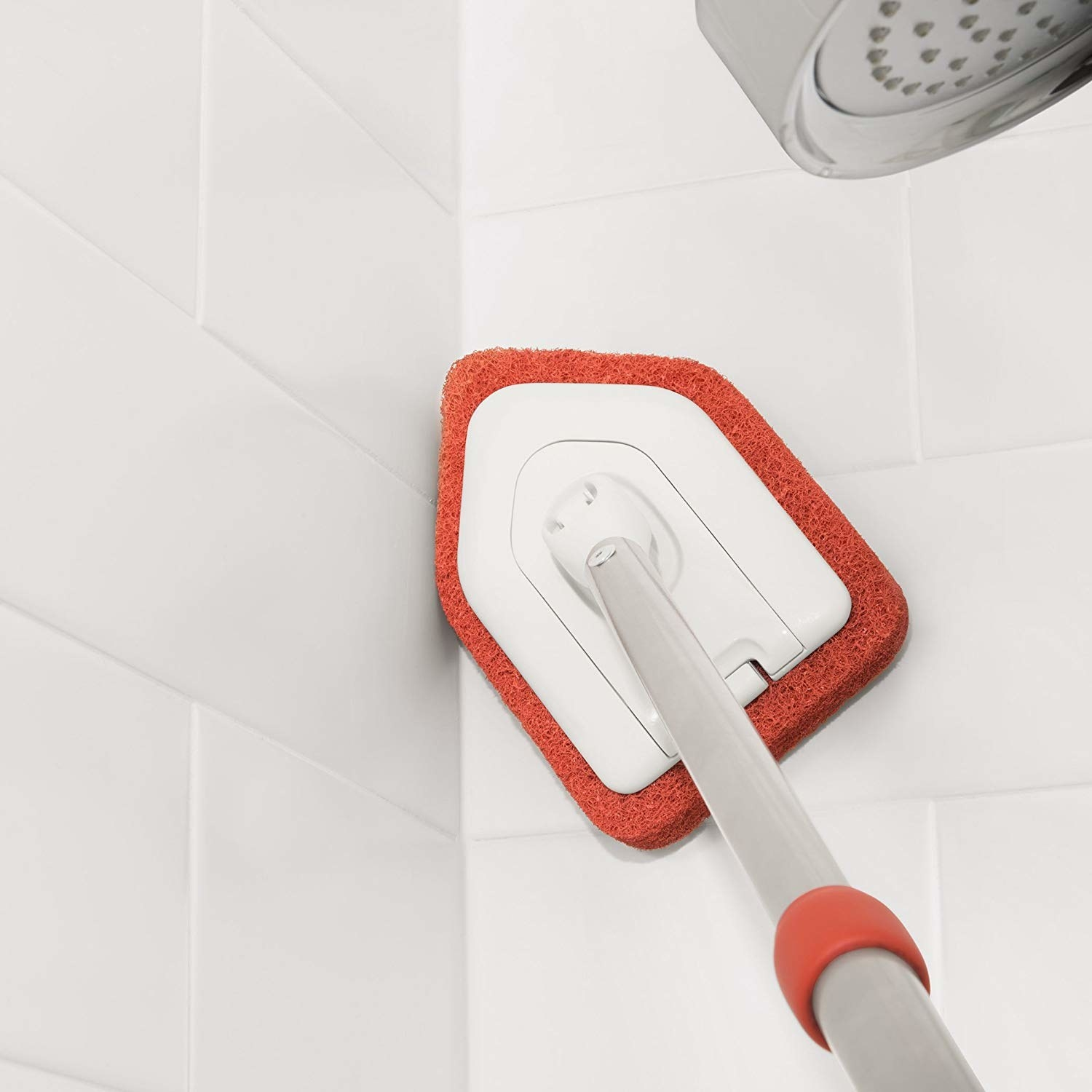 the pointy-front scrubber in a tile corner
