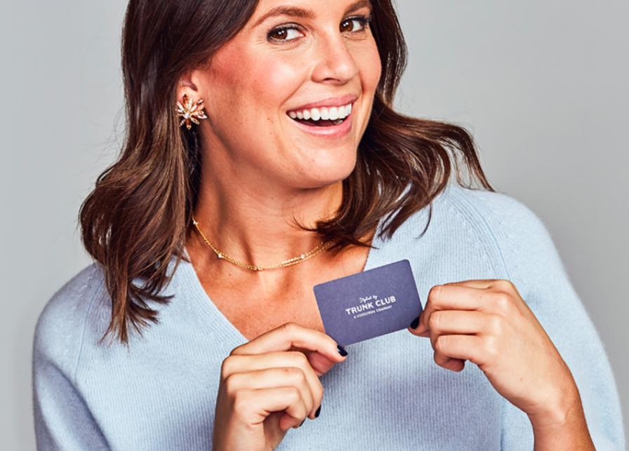 A person holding up a Trunk Club gift card.