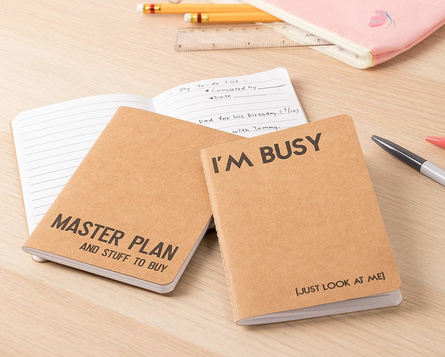 brown and black small notebooks