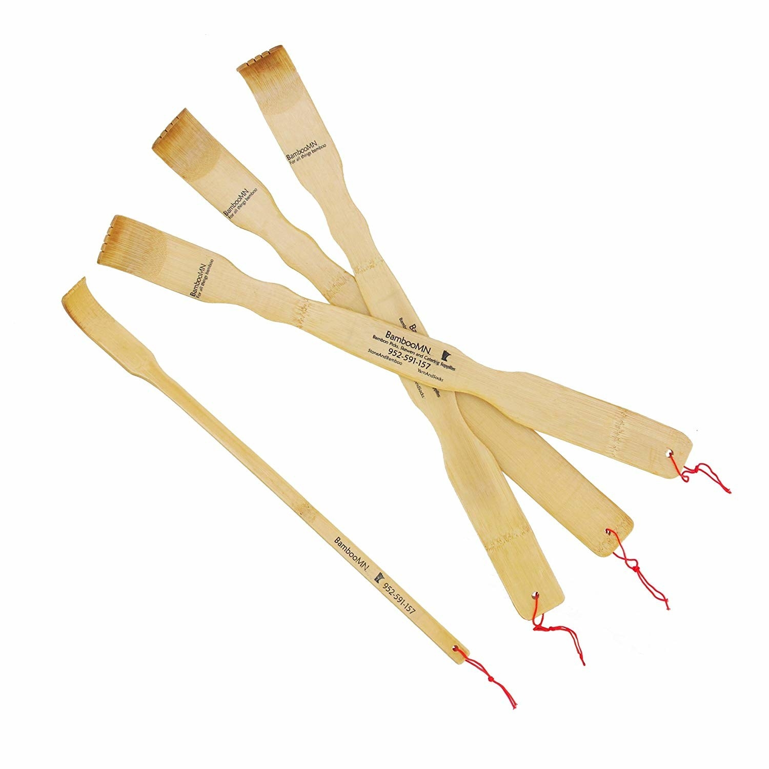 four bamboo back scratchers