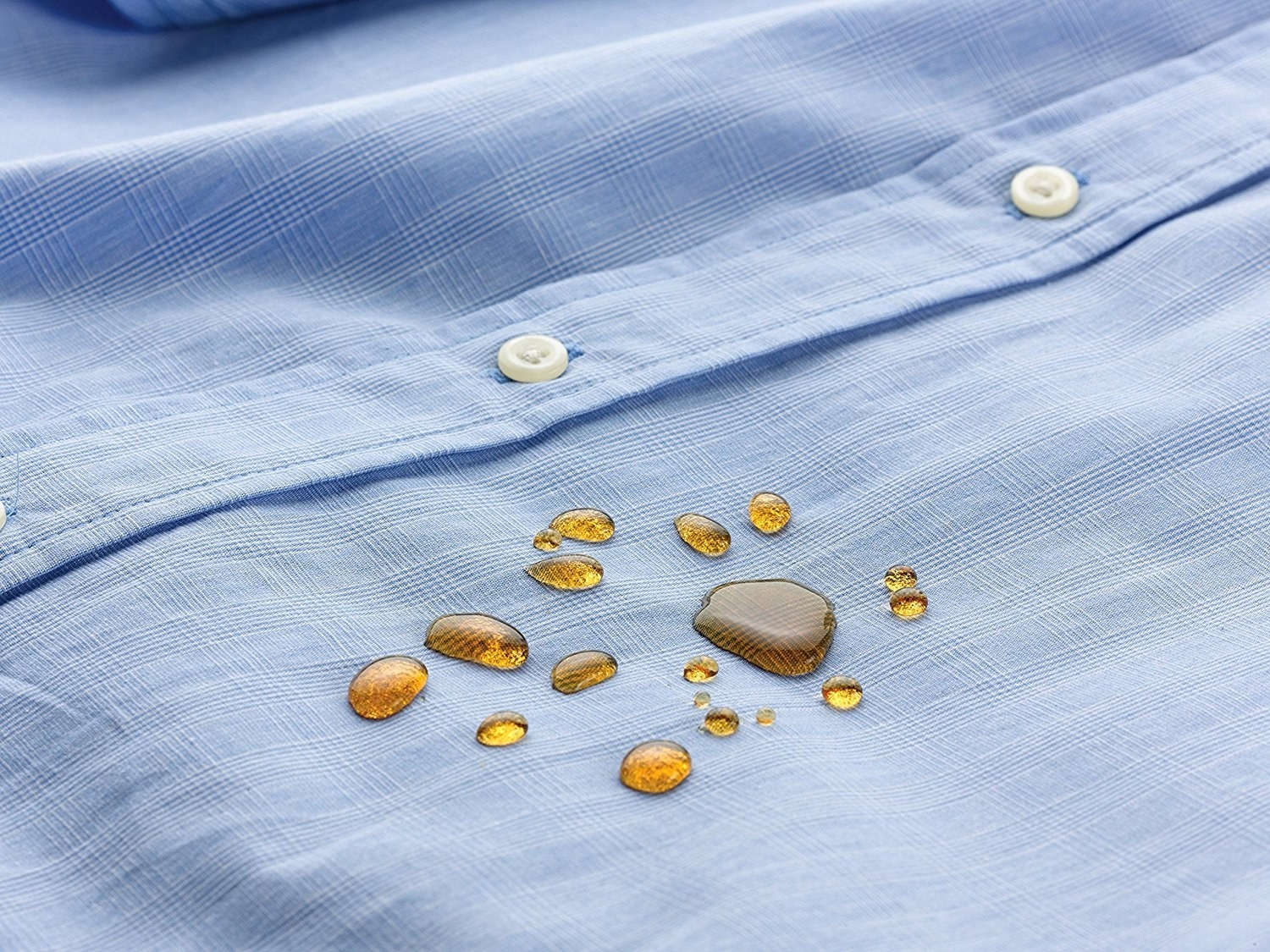 button up dress shirt with spilled soda on it beaded instead of soaking into the fabric