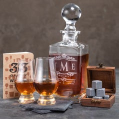 the decanter, whiskey stones, and glasses