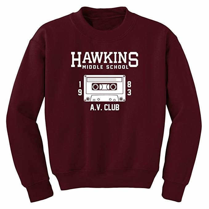"""On a scale of one to ten, they'll rate this gift an Eleven.Promising review: """"I love this sweatshirt! I'm not exaggerating when I say I was waiting by the mailbox for this to arrive. I'm 5'7"""" and weigh 165 lbs. and bought a size medium. It fits perfectly. I have room in the arms but the bottom hemline stops right at my hips. This sweatshirt is pretty thin, but for Stranger Things geeks such as myself, it's a must-have. Love this thing!!!"""" —MeriGet it from Amazon for $20.95+ (available in sizes S-5X and in four colors)."""