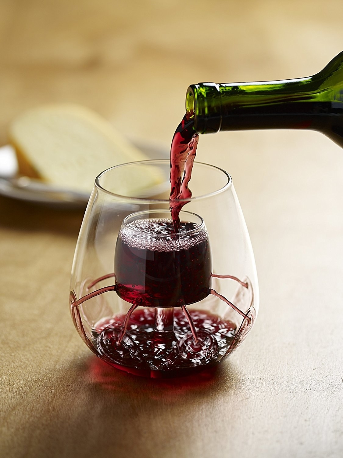 Aerating wine glasses with red wine in them