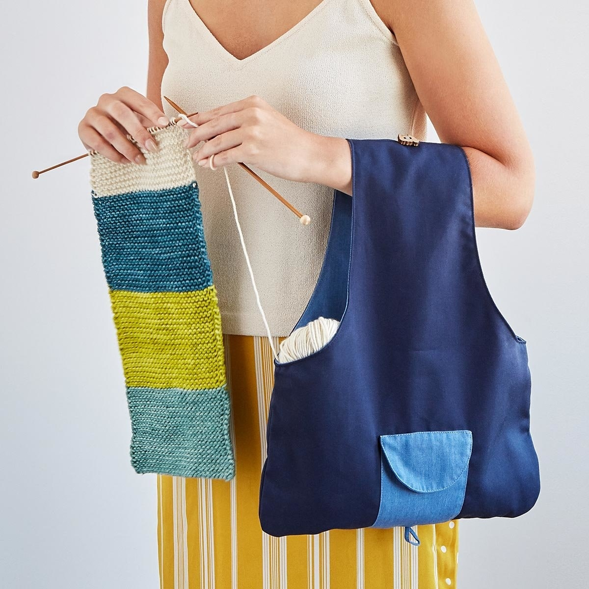 Model holding travel knitting bag