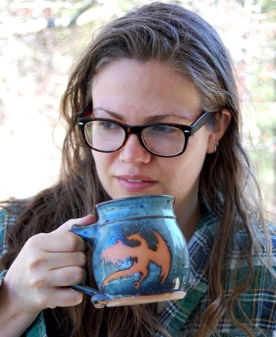 A model drinking out of the large mug