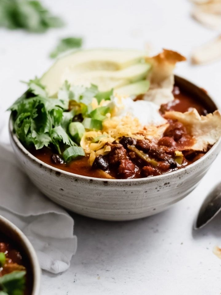 You have better things to do than stand at the stove all day. Toss your chili ingredients into the slow cooker in the morning and let dinner cook itself. Get the recipe.