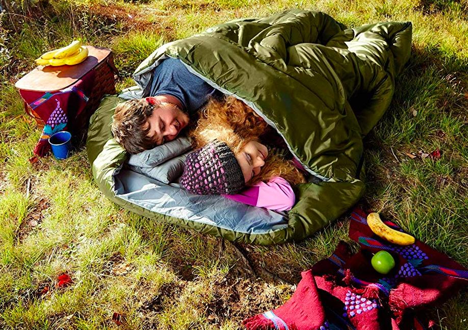 Two people sleeping side-by-side in large sleeping bag