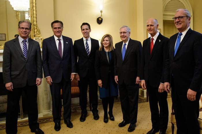 Incoming Republican senators pose with Mitch McConnell on Nov. 14.