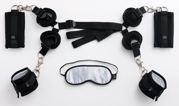 handcuffs, a blindfold, and leg restraints included in the kit